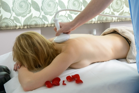 Woman gets therapy treatment at spa salon photo