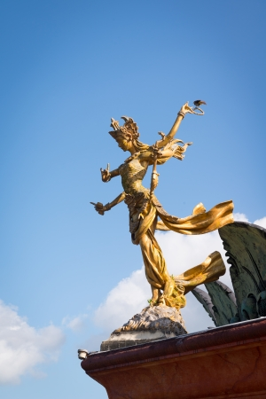 Six handed Bali goddes of dance statue against blue sky photo