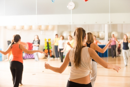 Dance class for women at fitness centre photo