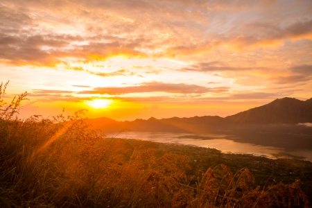 Beautiful sunrise over lake Batur in Kintamani, Bali, Indonesia photo