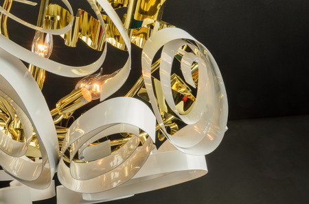 Contemporary glass chandelier fragment isolated over black background