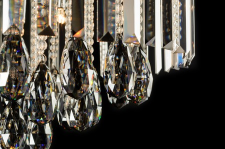 chandelier isolated: Contemporary glass chandelier isolated over black background Stock Photo