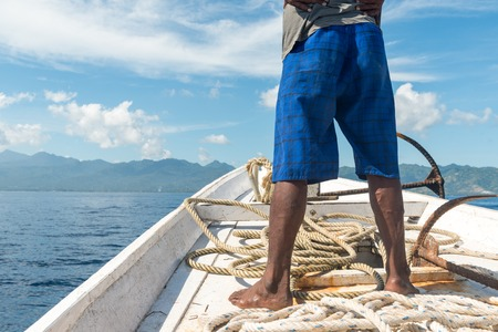 freshwater sailor: Fisherman standing on his boat during fishing trip in Indonesia