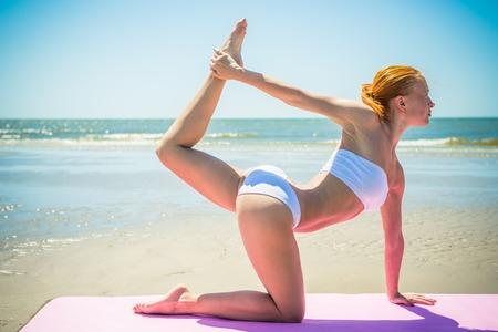 adult vietnam: Woman doing yoga asana at the beach Stock Photo