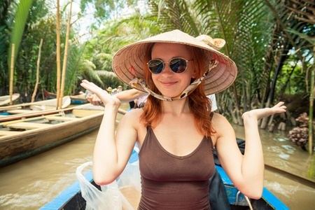 Tourist enjoying Mekong delta cruise with daily trips to local sights 版權商用圖片