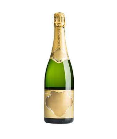 gold capped: New unopened plain bottle of brut champagne isolated on white
