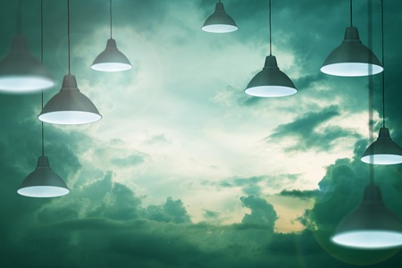 moody: Many lamps in the stormy moody cloudy sky as a symbol and concept of energy saving creativity