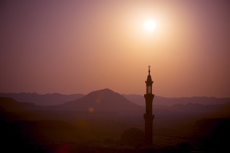 arabic desert: Sunset over desert with muslim mosque in the foreground Stock Photo