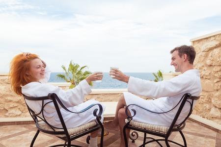 red bathrobe: Happy couple enjoying vacations at Red Sea, Egypt