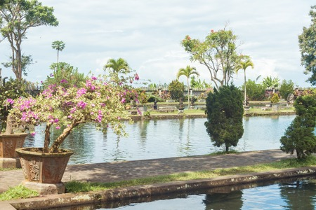 Tirtagangga water palace with fountains  and ponds on Bali, Indonesia