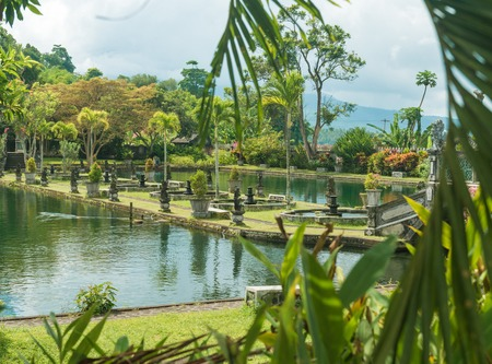 Tirtagangga water palace with fountains  and ponds on Bali, Indonesia photo