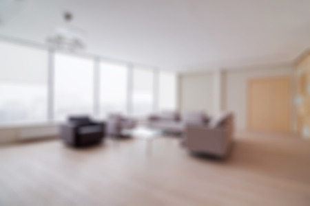 Modern office building interior with large sofa blur background