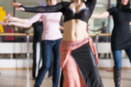 comely: Dance class for women at fitness centre abstract blur background