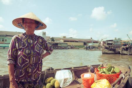 mekong: MEKONG DELTA, VIETNAM - April 25, 2014 - Asian floating market on Mekong river in Vietnam