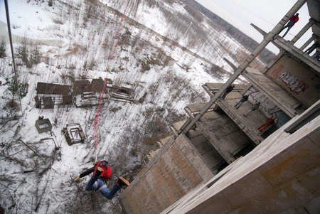 adrenaline: ZHELEZNODOROZHNIY, RUSSIA - March 9, 2008 - Rope jumping event held at the abandoned building construction site. Sports enthusiast groups organize such events for adrenaline lovers from all over Moscow district Editorial