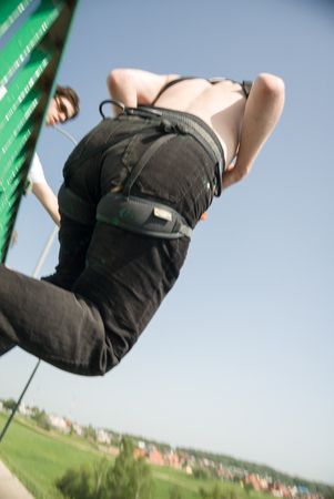 freefall: MOROZKI, RUSSIA - May 27, 2007 - Ropejumpers jumping off the bridge Editorial