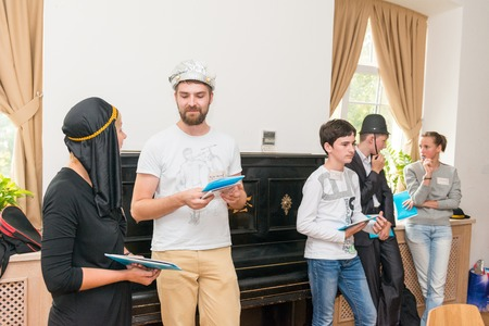 quest: MOSCOW, RUSSIA - August 31, 2014 - Participants of social quest role playing game with Arab Mystery Detective Investigation theme Editorial