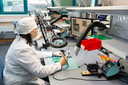 electronical: MOSCOW, RUSSIA - November 27, 2014 - Production of electronic components  at high-tech factory Editorial