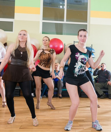 comely: MOSCOW, RUSSIA - November 18, 2012 - Dance class for women at fitness centre local gym Editorial