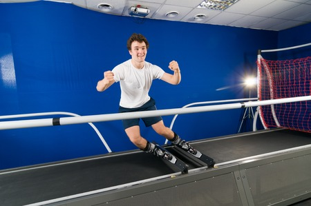 simulator: MOSCOW, RUSSIA - September 23, 2010 - Athlete working out on interactive ski simulator at the gym