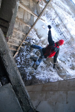 adrenaline: ZHELEZNODOROZHNIY, RUSSIA - March 2, 2008 - Rope jumping event held at the abandoned building construction site. Sports enthusiast groups organize such events for adrenaline lovers from all over Moscow district
