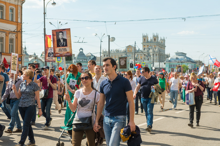 immortal: Moscow, Russia - May 9:  Immortal Regiment  marches on. Moscow celebrates 71-th Victory Day anniversary on May 9, 2016 in Moscow.