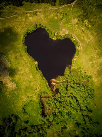 former: Beautiful heart-shaped lake. Natural heart-shaped lake in the former bend of the river Stock Photo
