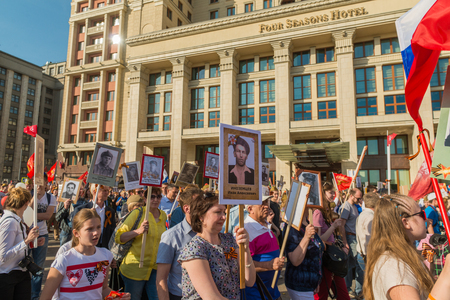 militiaman: Moscow, Russia - May 9:  Immortal Regiment  marches on. Moscow celebrates 71-th Victory Day anniversary on May 9, 2016 in Moscow.