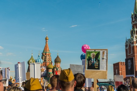 regiment: Moscow, Russia - May 9:  Immortal Regiment  marches on. Moscow celebrates 71-th Victory Day anniversary on May 9, 2016 in Moscow.