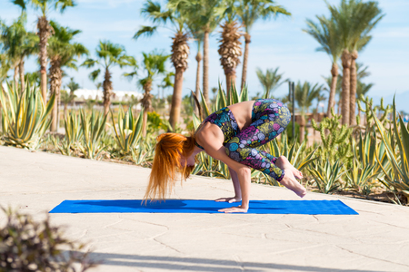 Woman doing yoga asana at the beach Stock Photo