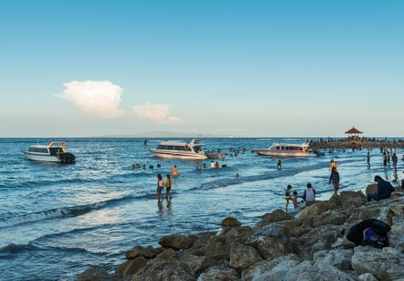 sanur: Sanur, Bali Indonesia - April 21, 2013 - Lots of people on the beach enjoy nice weather