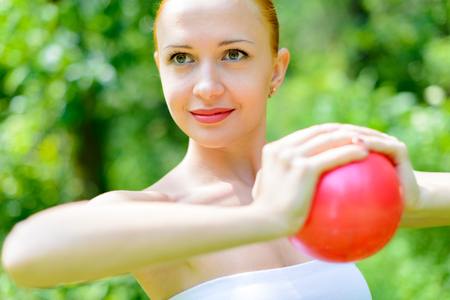 Red woman fitness instructor Stock Photo