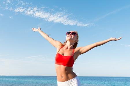 Cheerful young woman at the sea Stock Photo