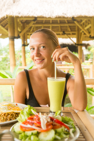 Woman eating healthy lunch