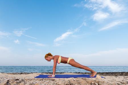 Slim woman practicing plank pose Stock Photo