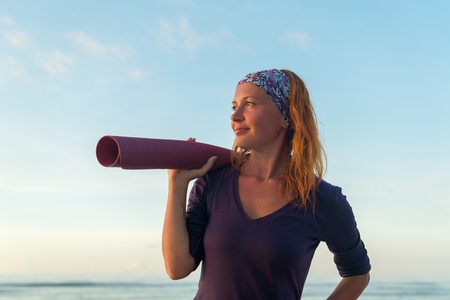 Woman with yoga mat Stock Photo