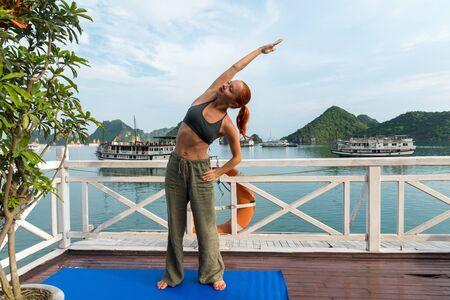 Young woman practicing yoga Stock fotó