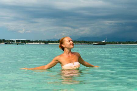 Woman at tropical island beach