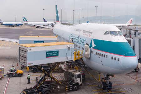 HONG KONG, CHINA - April 17, 2013: Cathay Pacific Airplane docked getting ready to flight at Hong Kong International airport