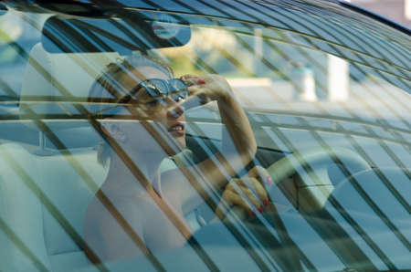 Woman driving a car Banco de Imagens
