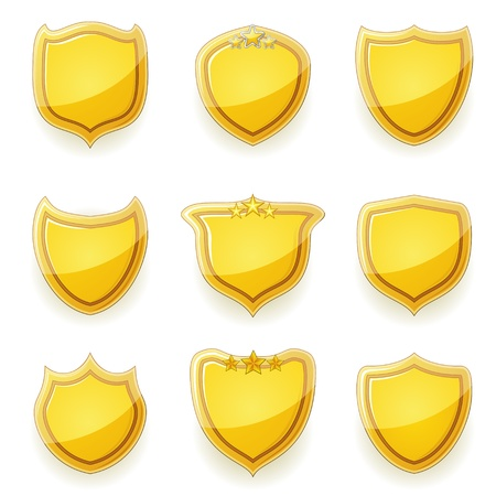 Set of nine gold blank shields of different shapes