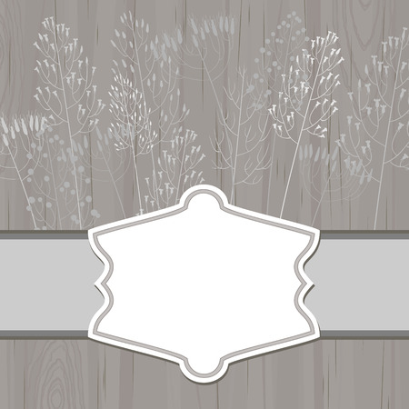 dry grass: Gray wooden background with blank retro label and dry grass