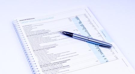 cash flow statement: cash flow statement with pen on white background