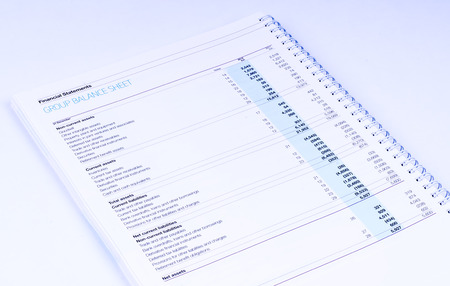 group balance sheet on white background photo