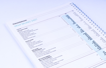 group financial statements on white background photo