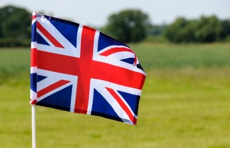 flying union flag outside in fields photo