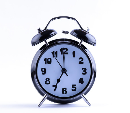 Alarm clock on white with  seven o Imagens - 25300443