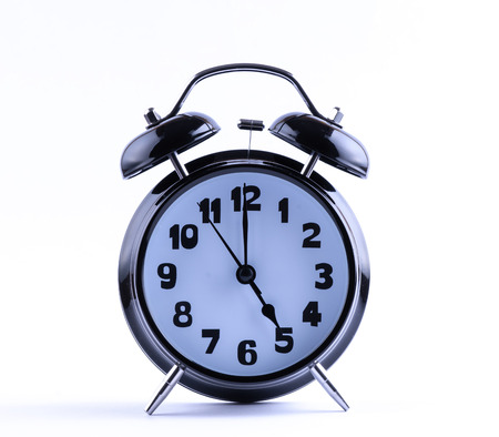 Alarm clock on white with  five o Imagens