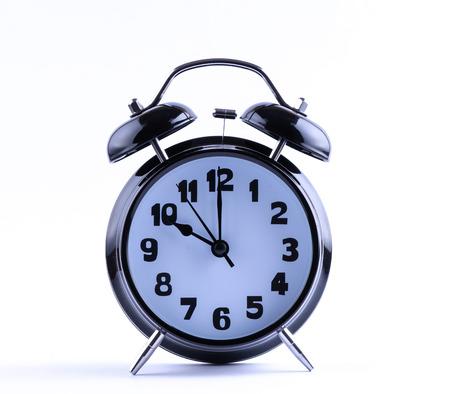 12 o'clock: Alarm clock on white with  ten o Stock Photo