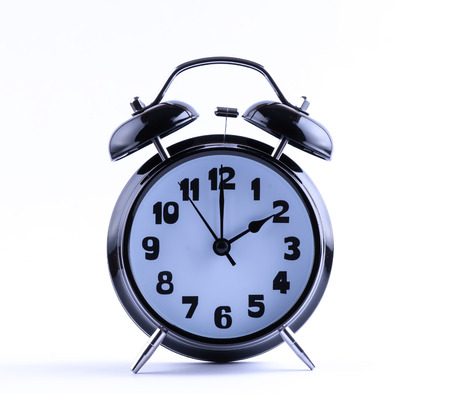 12 o'clock: Alram clock on white background with two o Stock Photo